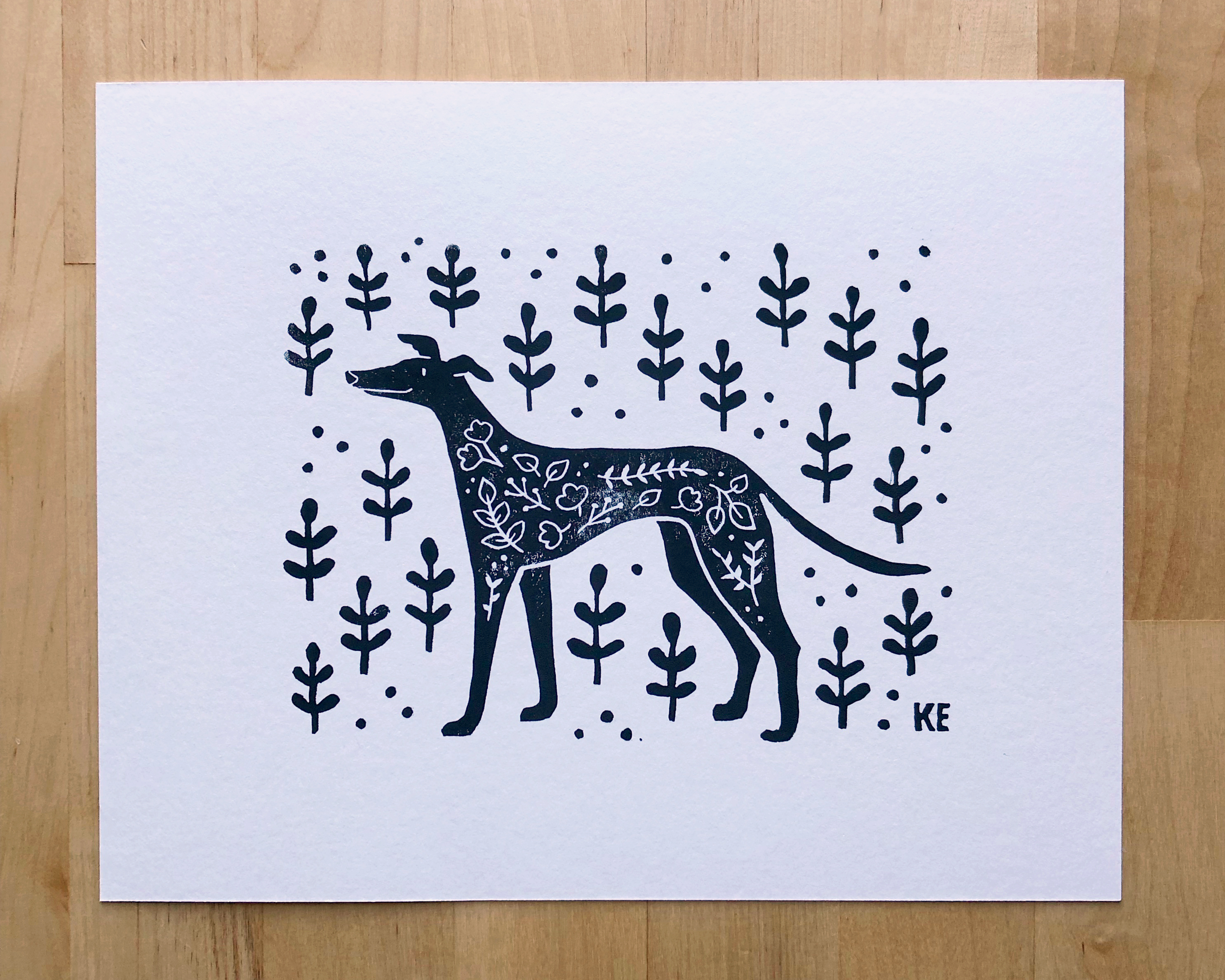 Block Print of a greyhound surrounded by plants