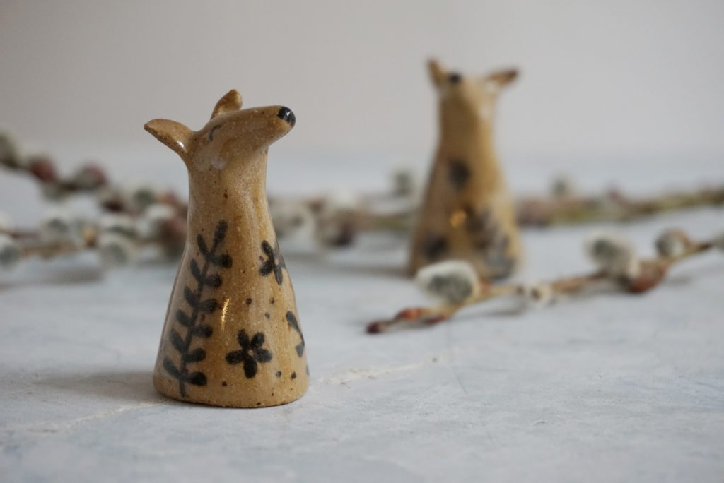 two ceramic dog figurines