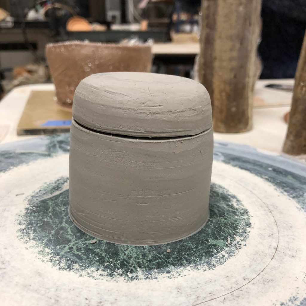 A lidded jar made of clay