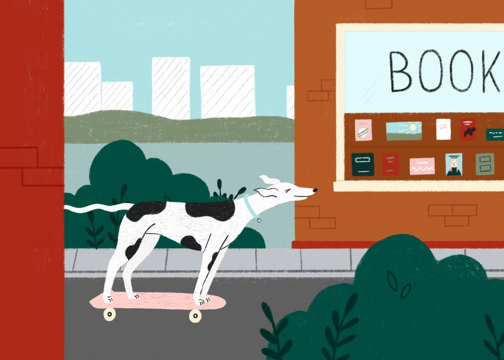 A greyhound skateboards past a book store