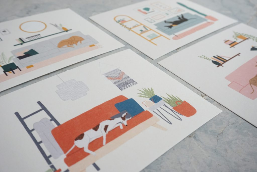 A close up image of art prints featuring greyhound illustrations